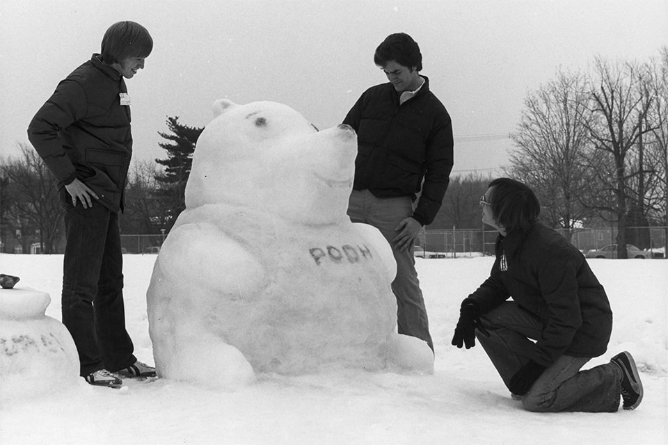 Group of Loyola students making a Winnie-the-Pooh snow sculpture