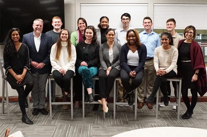 Student and faculty members of the Social Impact Fellowship program pose for a photo