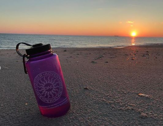 OAE Water Bottle in Sand during Sunset
