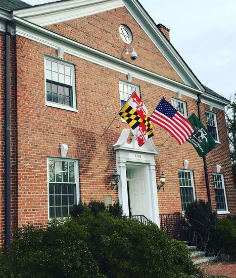 Alumni house with Maryland and Loyola flags