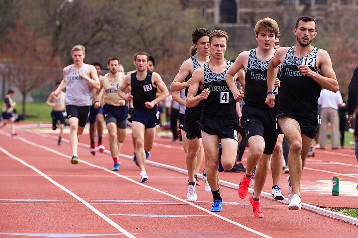 Loyola athletes running in a track and field meet.