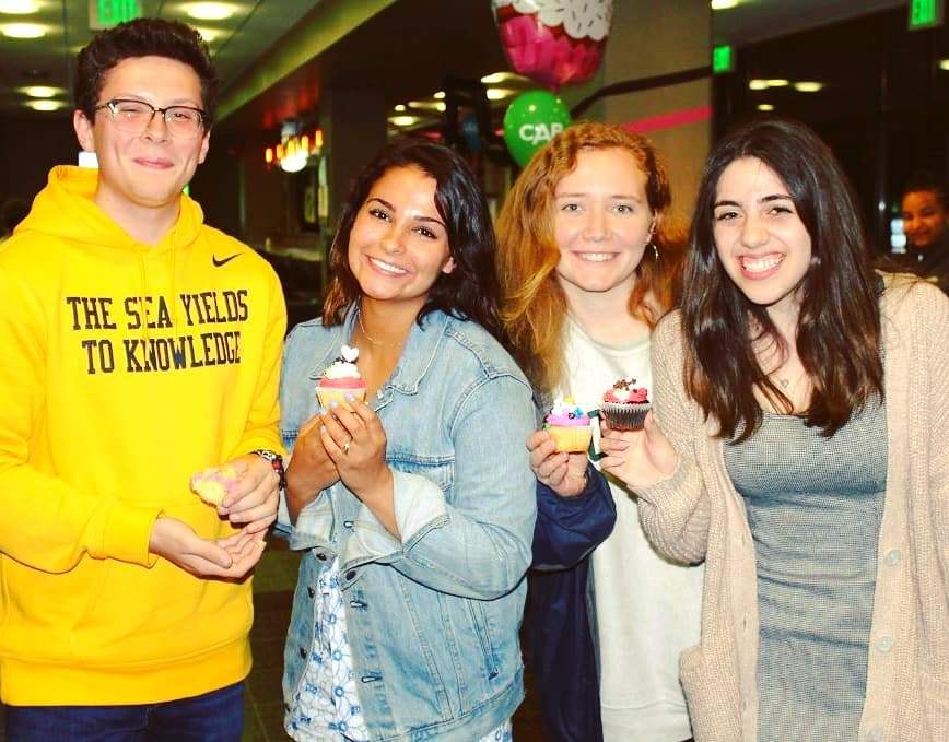 Students at a Loyola Late Night event with cupcakes