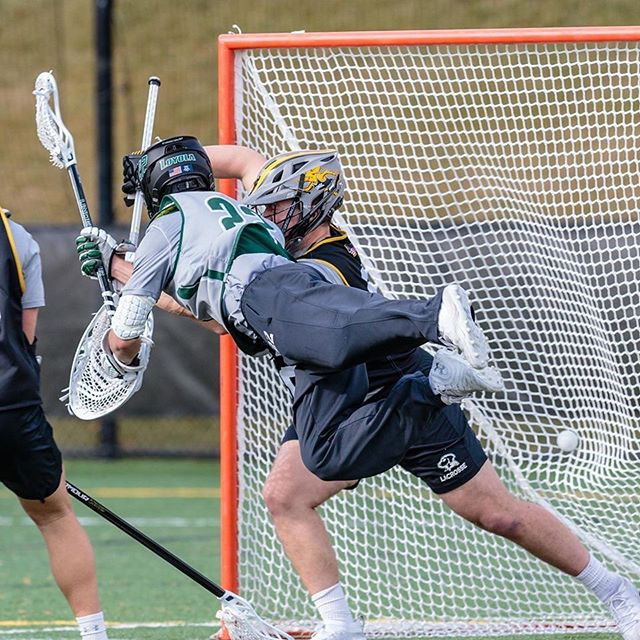 Lacrosse player taking a shot in midair