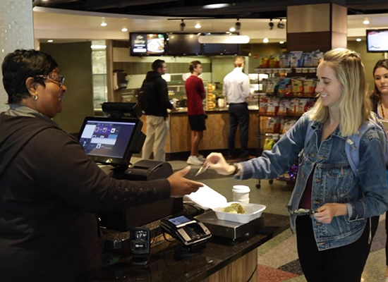 Student paying for meal at Boulder Garden Cafe