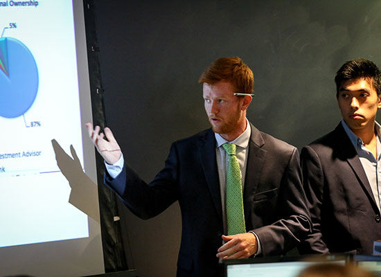 Two students giving a professional-level presentation.