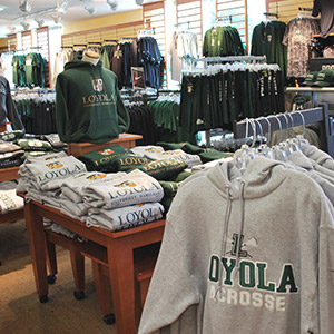 Loyola sweatshirts and t-shirts hanging in the Loyola Bookstore