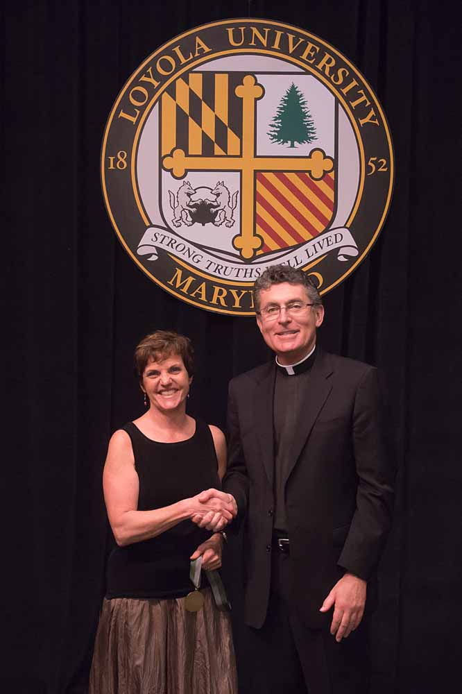 Janet Price (accepting award for Anne Spinelli), Fr. Linnane