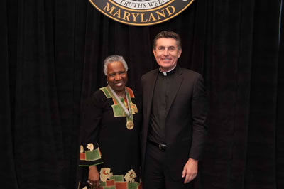 Linda Ellard Mouzon and Father Linnane