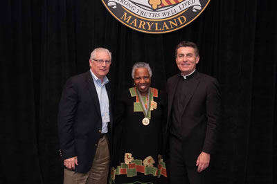 L. Mickey Fenzel, Linda Ellard Mouzon, and Father Linnane