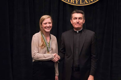 Kate Elizabeth Beres and Father Linnane