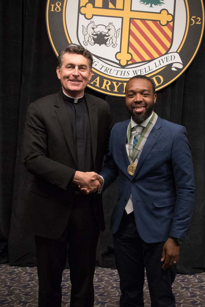Father Linnane and Sedrick Smith