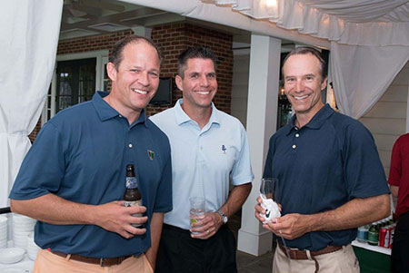 Golfers enjoy drinks after the invitational