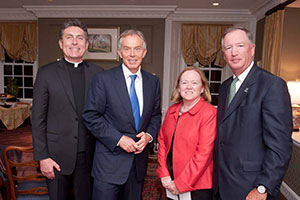 Rev. Brian Linnane, S.J., president of Loyola University Maryland, Mr. Blair, and Ed and Ellen Hanway at a private reception at the President's residence