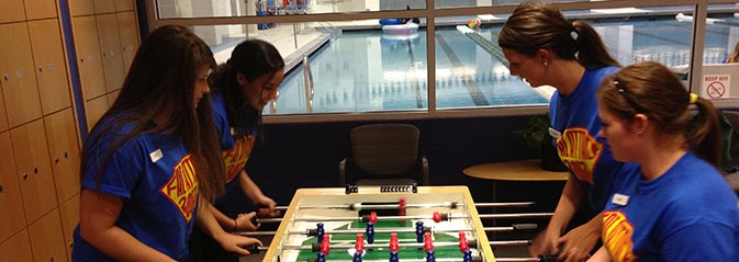 Students playing foosball during orientation
