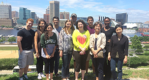 2015 Baltimore Health Immersion students in front of Baltimore skyline