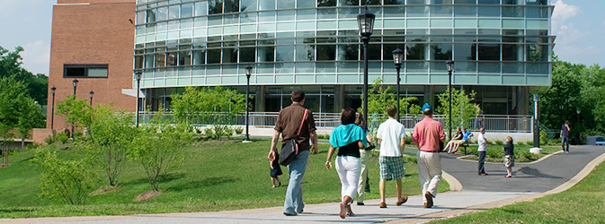 Students walking towards library