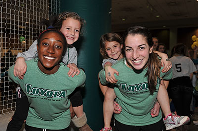 Loyola students with participants of Women in Sports Day