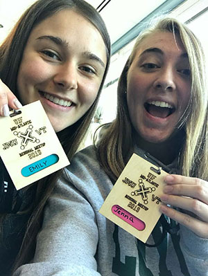 Emily Cebulski and Jenna Bower excitedly holding credentials
