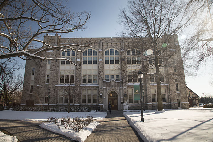 Loyola's Jenkins Building in winter with snow on the ground