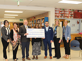 School of Education presenting check to Overlea High School