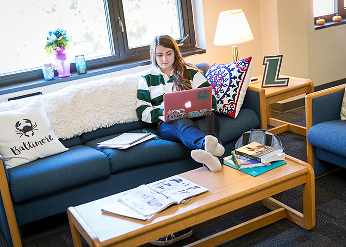 Student sitting on couch in residence hall