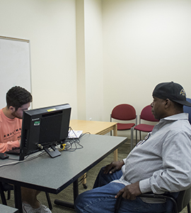 2019 Free tax clinic with Loyola student helping a client