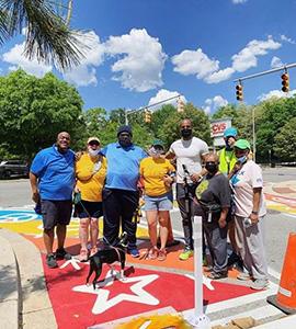 York Road Initiative volunteers pictured on crosswalk art installation along York Road