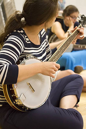 A Loyola student plays an instrument