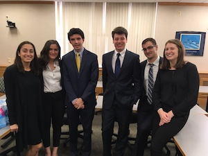 Members of the 2018 Fed Challenge team await the results of their recent competition.