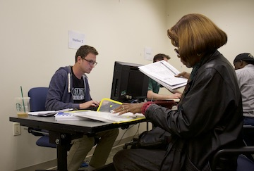 Loyola student assists community member with taxes