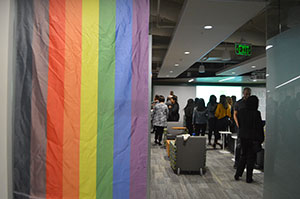 Rainbow flag/banner at the entrance of a gathering space