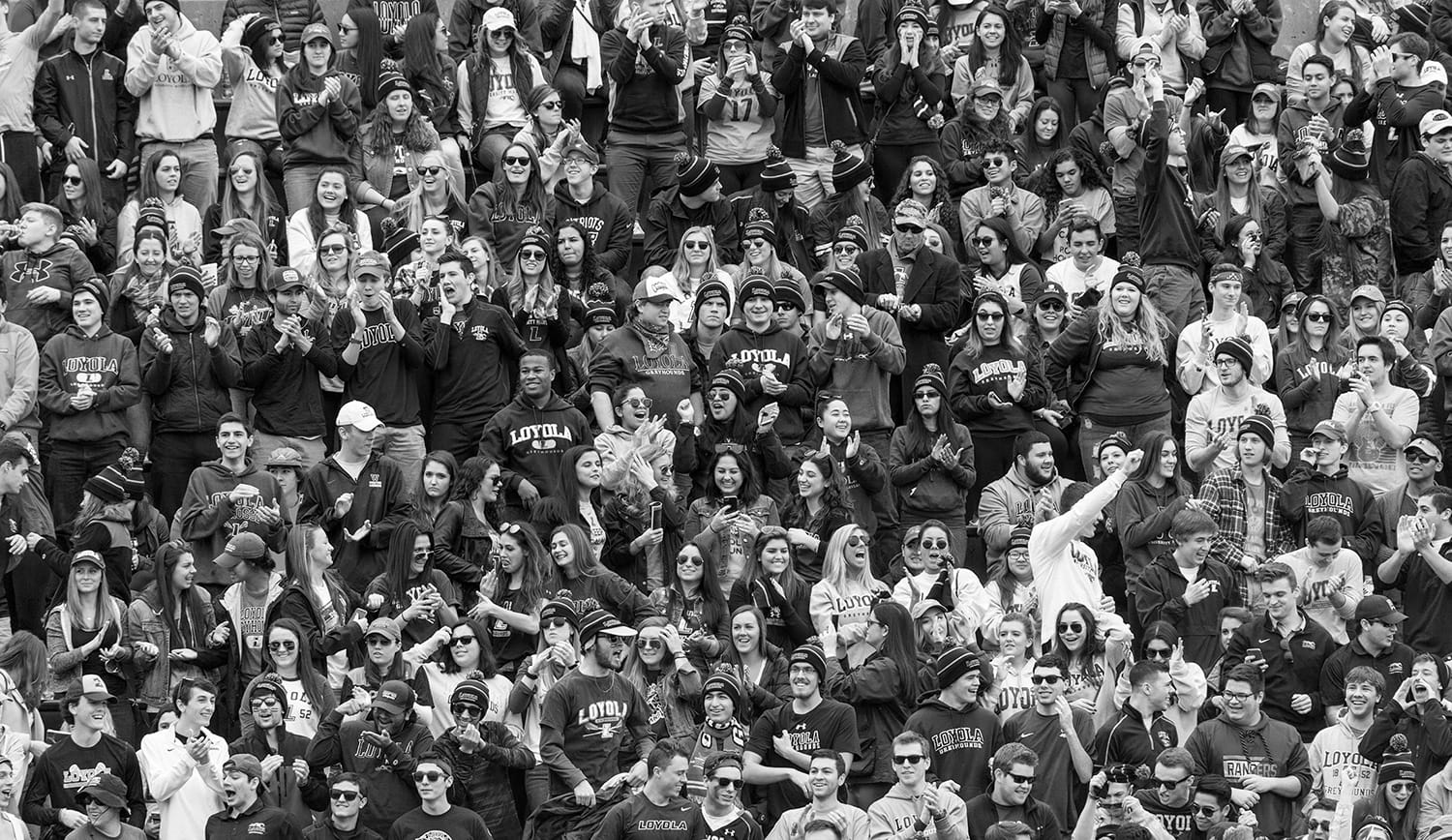 A crowd of Loyola students cheering at an athletics game