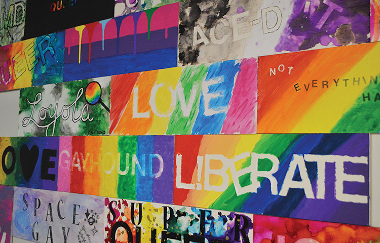 A colorful mural on a wall showing support for LGBTQ+