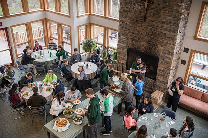 Birds-eye view of students eating in the retreat dining hall