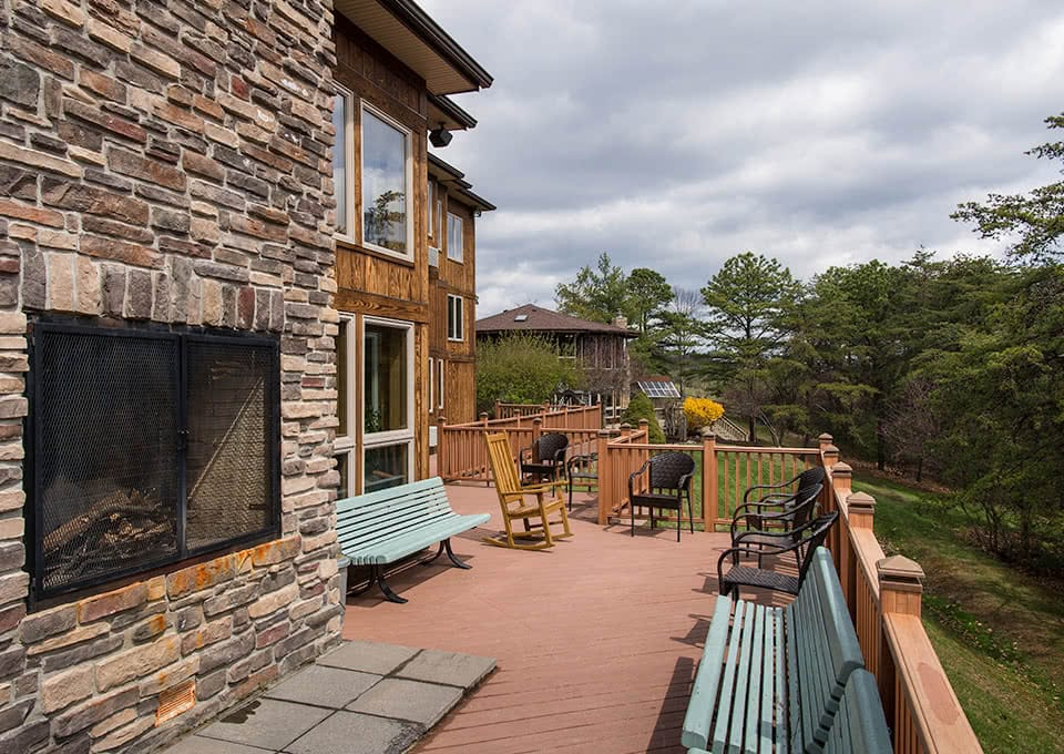 Back porch with a fireplace and seating