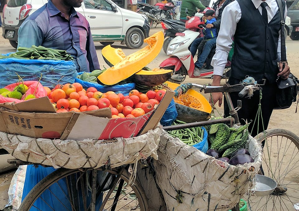A man sells vegetables from his bicycle