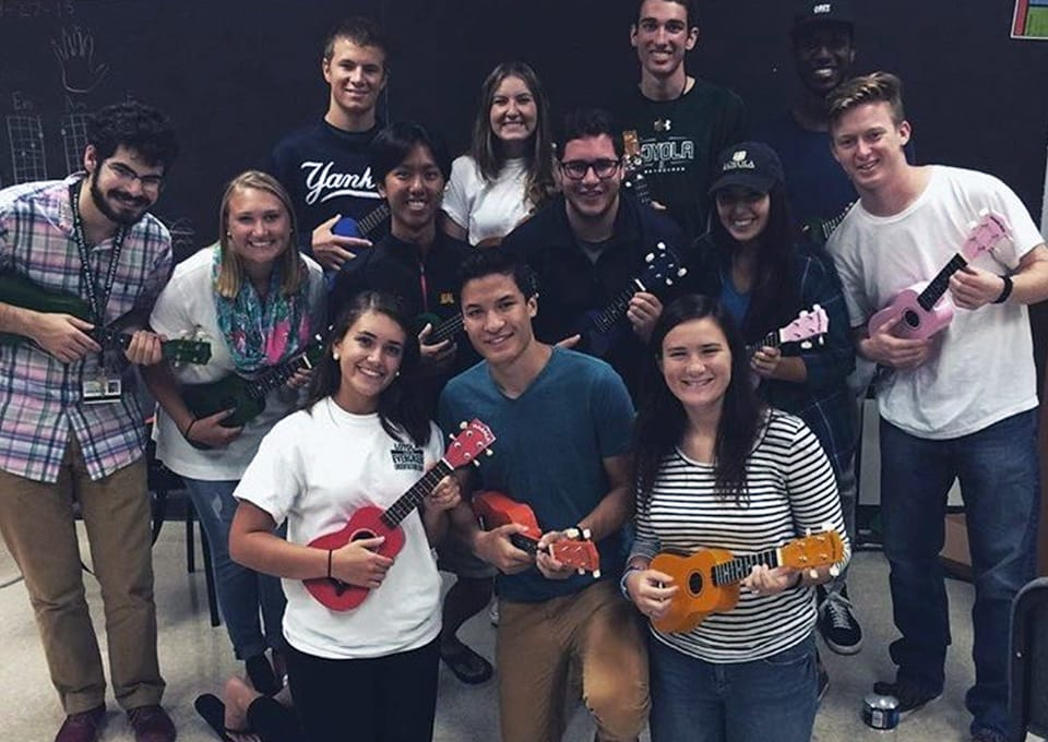 A large group of students posing with ukuleles