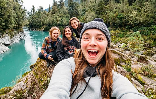 A group of students taking a selfie in the wilderness