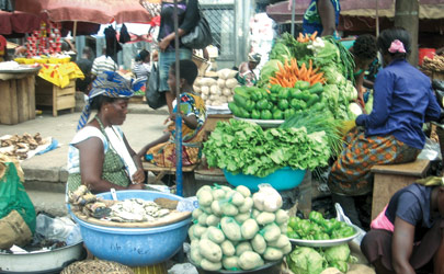 Vendors sell produce at an open-air market in Accra, Ghana