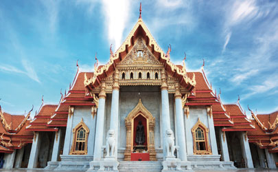 The exterior of a palace on a bright and sunny day in Bangkok, Thailand