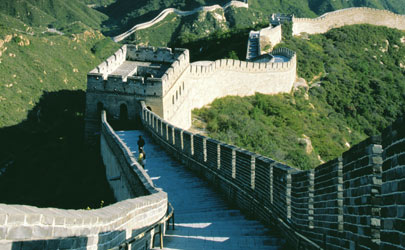 Tourists walk down the pathways of the Great Wall of China