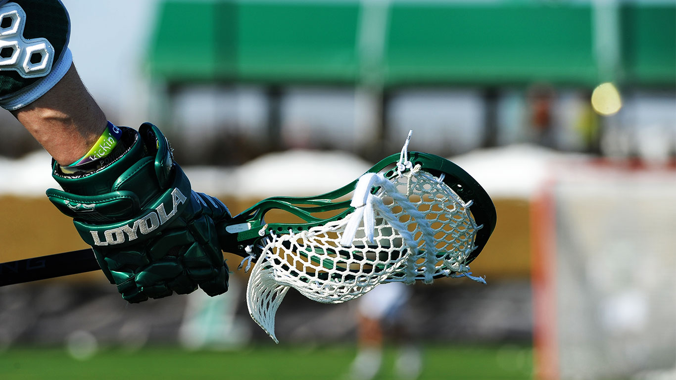 Closeup photo of the mesh on a lacrosse stick of a Loyola player