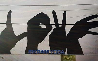 Street mural of four silhouetted hands spelling the word 'LOVE' in the Hampden neighborhood in Baltimore
