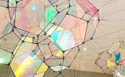 An art installation of geometric glass structures refract various colors of light at the Baltimore Museum of Art
