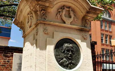 A decorative memorial to Edgar Allan Poe with a carving of his likeness on it