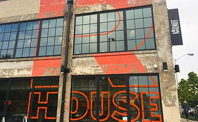 A large, orange logo that reads