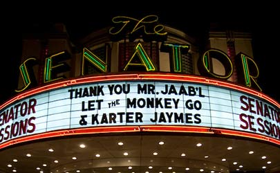 Theatre marquee displaying various messages outside the Senator Theater in Belvedere Square, Baltimore